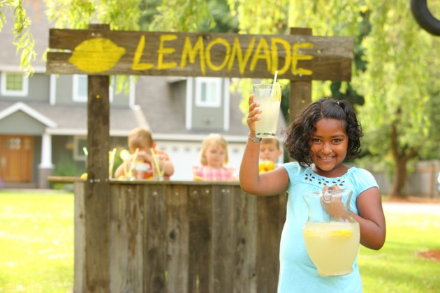 Young girl selling lemonade on a stand